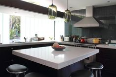 mike and I want to remove a wall to open up living space and kitchen, replacing it with an island. I like this idea. It works as a place to eat and a place to cook. and the measurements for countertops aren't tricky :)