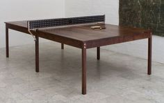 BDDW ping pong / dining table.   Fits the SoHo house look they like! comes with leather ping pong paddles!