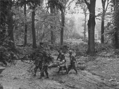 British soldiers carried the wounded on stretchers during the battle near the hotel 'Hartenshteyn' (Hartenstein) in the Dutch village of Oosterbeek (Oosterbeek).