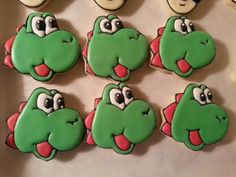 Yoshi hand cut and decorated sugar cookies by Baked Ambition.