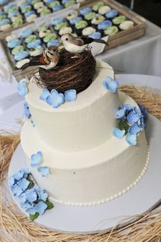 Rustic Wedding Cake/cupcakes in background