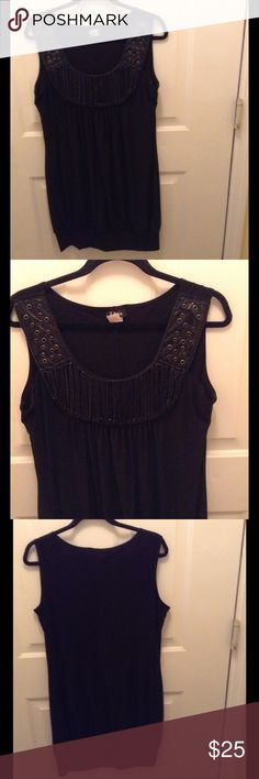 Taboo Tunic Top This solid black sleeveless tunic is embellished on the front neckline with cut out patches & lightweight chain links.  It's 35 inches long and 92% Polyester/8% Spandex. Taboo Tops Tunics