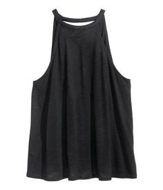 Black. Top in slub jersey with a slight sheen. Low-cut V-neck at back and narrow…