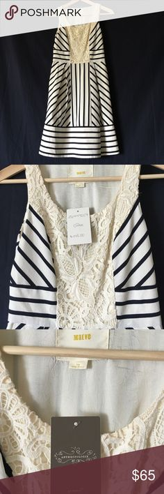 Anthropologie dress by Maeve.  Never worn, tags on Cream color with navy stripes and lace detail. Full sized pockets. Never worn, tags attached. 98%cotton, 2% Lycra.  Fully lined. Side zipper. Anthropologie Dresses