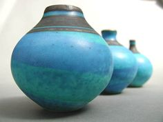 Ceramics by Richard Baxter at Studiopottery.co.uk - Three turquoise vases largest in foreground is 8.5cmD  9cmH, 2007.