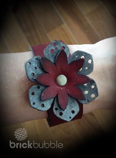Laser cut leather flower cuff. www.brickbubble.ca
