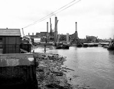 """Deptford Power Station photographed in 1973 - it was demolished in The Millennium Quay housing development now stands on that site."" On the Thames in the London Basin Coal fired power stations existed up to the = smog Pigeon House, Tate Britain, Fleet Street, Valley Road, London History, South London, New York Skyline, Black And White, Travel"