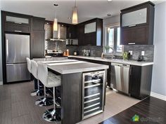 While contemporary kitchen design has been veering away from the monochromatic white kitchen look, we see more appearances of heavily black kitchens, with Living Room Kitchen, Home Decor Kitchen, Interior Design Kitchen, New Kitchen, Kitchen Island, Luxury Kitchens, Cool Kitchens, Contemporary Kitchen Design, Best Kitchen Designs