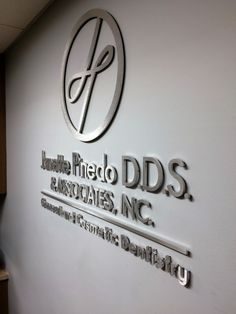 This is a dimensional letter lobby sign that we made by routing the letters and logo from brushed aluminum. Janette Pinedo's office design was recently features on Off the Cusp! #signage #office #interiordesign