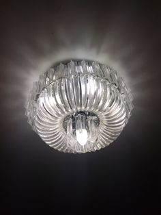 Round ceiling chandelier look hard plastic not glass so not heavy in the ceiling includes 6 bulb, 1146370265