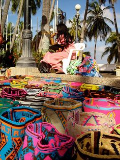 bags & baskets made by the Wayuu people in Guajira, a rural region that saddles Venezuela and Colombia. Bolivia, Ecuador, Boho Bags, South America Travel, Tapestry Crochet, Textiles, Latin America, Continents, Bunt