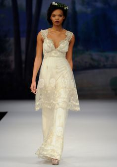 LYON    Spring 2012  Vintage cameos embroidered on tulle layered over cotton with guipure cotton lace sweetheart neckline