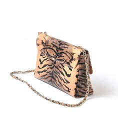 Is your ensemble feeling a dull? Step out and go a little wild with our animal printed #handbag. You will be surprised how versatile it is. This bag can carry your essentials from day to evening. www.icarryalls.com