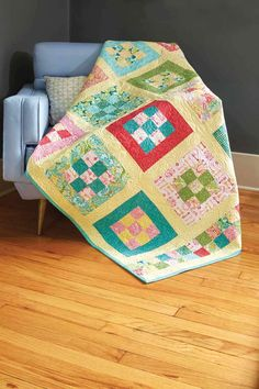 Always a favorite, the Nine-Patch quilt block is simple alone or prominent when framed, as in Nine Patch Park, by Sue Pfau. The checkerboard borders add to the scrappy look of this throw quilt pattern.