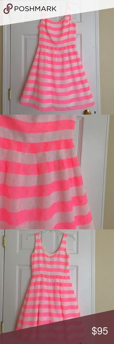 Lilly Pulitzer pink and white striped tank dress Welcome to summer! A great fluorescent pink and white stripe! There's a layer underneath to make the skirt a little fuller. 100% polyester. EUC. 36 inches long. Lilly Pulitzer Dresses