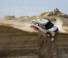 World Rally Championship driver drives off 20-foot cliff, lands upside-down, walks away (Photo: Handout / AFP - Getty Images)