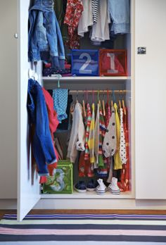 Hang the clothes pole lower when they're little and move it up when they're big. Wardrobes with adjustable insides, like PAX, provide convenient storage that grows with your family.