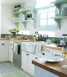 this says french country kitchen to me: ORB fixtures and pulls, chopping block counter... simple and pretty