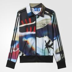 adidas Originals celebrates over 40 years of sneaker love. This women s  Firebird track top is d9f866ba2b8