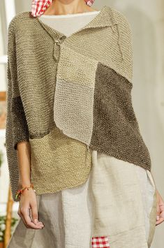 hand knitted patchwork sweater. drape, boxy silhouette, asymmetrical simple closure, lightweight layering piece