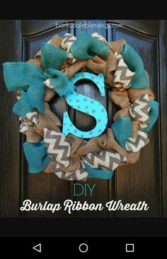 Turquoise, chevron and tan burlap monogramed wreath. They should have used different paint on the letter. So I love this minus the uncoordinated bright blue letter.