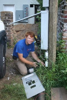I would be fixing electrical boxes like this guy in the picture is and be wearing something similar to him too.