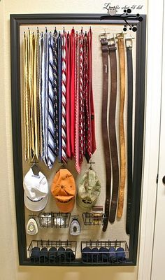 DIY: a closet organizer for HIM -its a peg board (lowe's will cut for you) covered by fabric and framed - then buy the hooks and baskets that you need