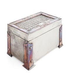 Lot 135  SCOTTISH CELTIC REVIVAL PEWTER AND COPPER BOUND PRESENTATION CASKET, DATED 1911 13.5cm wide, 8.5cm high, 8.5cm deep  Estimate: £1500  - 2000