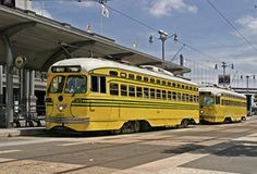 This streetcar is painted to honor Cincinnati, which ran PCC streetcars from 1939 to 1951. Cincinnati was unique among North American streetcar systems in requiring two overhead wires for streetcars, one to supply electrical power, the other to provide a ground and complete the circuit. This arrangement grew from an early and (pardon the pun) groundless fear of electrocution from the standard streetcar practice of returning current through the tracks. (Trolley buses use two wires because…