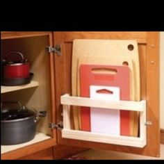 attach narrow rack inside low kitchen cabinets for lids, knives, cutting boards, etc.