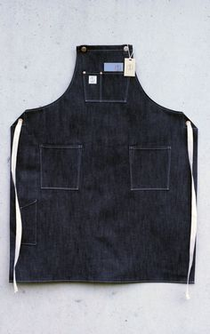 Dawson Denim - British Hand Made Denim Workwear, Aprons and Bags. Japanese Red Line Selvage Denim. — The Mercantile Apron, Selvage denim, inspired by shopkeepers workwear, Made in Great Britain. Linen Apron, Apron Diy, Barista, Shop Apron, Work Aprons, Denim Art, Street Style Shoes, Aprons For Men, Denim Ideas
