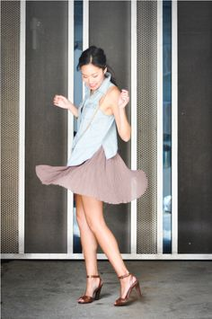 Anh wearing our Accordion Pleat Mini Skirt: http://www.alainnbella.com/default/accordion-pleat-mini-skirt.html