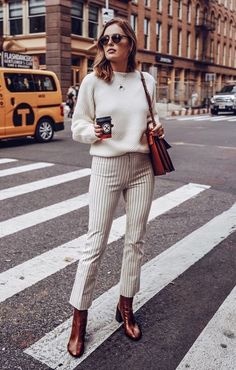 The Fall Trends Every Fashion Girl Will Be Wearing, striped pants, styling striped pants, statement pants, styling booties, brown booties, styling cream sweater, cream sweater style, street style, street style 2018