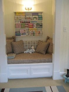 Reading book in landing space. I love this idea. Take out closet doors and make it into a reading area.