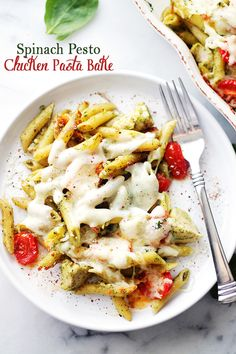 Spinach Pesto Chicken Pasta Bake - A delicious and easy recipe made with chicken, whole wheat pasta and tomatoes tossed in a creamy spinach pesto sauce and topped with cheese.