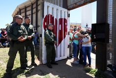 Members of the Reyes family embrace at Border Field State Park in San Diego on April 30. US Border patrol agents opened a single gate to allow families to reunite for three minutes along the Mexican border on Children's Day in Mexico.