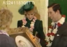 November 24, 1983:  Prince Charles & Princess Diana are presented with a portrait of Prince William after opening the Asian Centre in Walthamstow, London