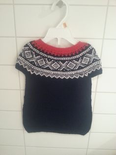 Every Norwegian have to have something with the Mariuspattern on it.  Babytunic