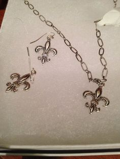 Welcome to Giseles - Necklace or Earrings with Detailed Fleur de Lis