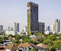 Somdoon Architects' IDEO Morph 38 Tower is Wrapped With Living Green Walls in Bangkok