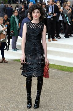 Singer St. Vincent showed off her body in a revealing black dress and thigh-high booties.