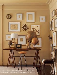 Traditional office/library by Suzanne Kasler Interiors Prints and drawings by Pablo Picasso, Carolyn Carr, and others fill a wall in the family room of Suzanne Kasler's Atlanta home; a drafting table bears a picturesque arrangement of antique globes. Home Office Design, Home Office Decor, Home Decor, Office Ideas, Office Nook, Office Art, Design Entrée, House Design, Wall Design