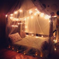 Canopy bed with string lights More