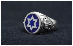 Star of David and two elephants on sterling silver signet ring with blue enamel