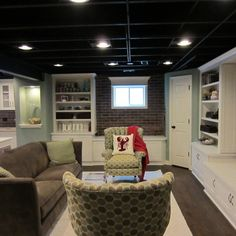 I love this look for the basement.  Maybe I can make a faux brick wall?  White built ins.  Love.