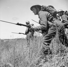 Belgian troops advance with fixed bayonets during training in Wales, 8 July 1941.