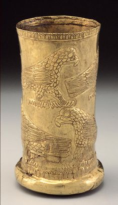 Beaker with Raptors Provenance	western Iran Period	14th - 13th century B.C. Materials	Electrum Dimensions	H-12.1 D-7