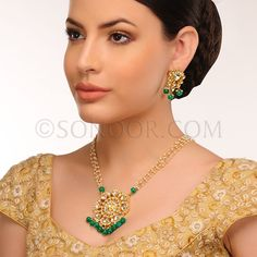 PEN/1/3419 Kayya Pendant Set with Earrings in dull gold finish studded with kundan stones and hanging green jade droplets 	 $238	 £140