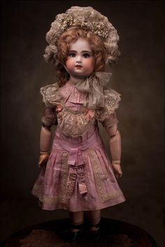 Antique French Bebe Tete Jumeau with teeth 1890-1900. Ironically, the dolls sold with teeth were more popular than the closed mouth Bebe dolls, making them more plentiful now which in part makes them less valuable than the now rarer closed mouth models.