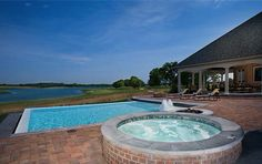 Classic Pool & Patio design with attached gunite spa and amazing water features.